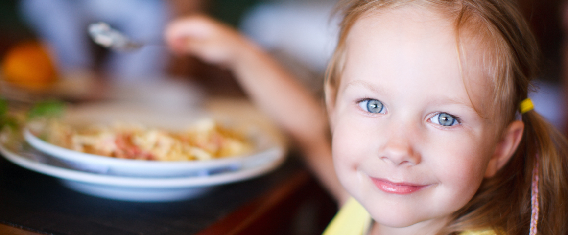 picture of little girl eating